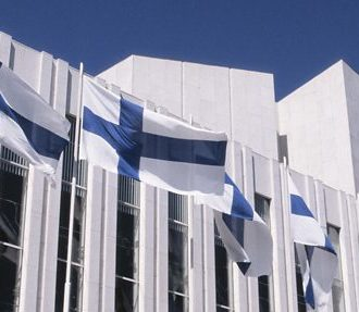 Finnish flags flying in front of the Finlandia Hall.