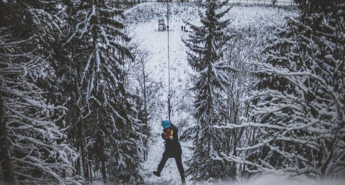 """""""Yoiks and away!"""" A blogger sails down a zipline in the forest outside of Porvoo."""