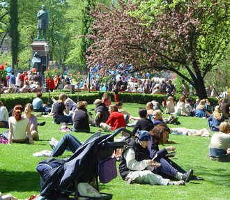 Time for some sun: Helsinkians stretch out on the green expanses of the Esplanade to enjoy the good weather.