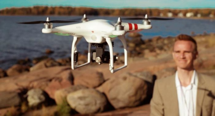 Lare Lekman poses with the camera-carrying quadcopter that allows him to film bird's-eye views of the Finnish capital.