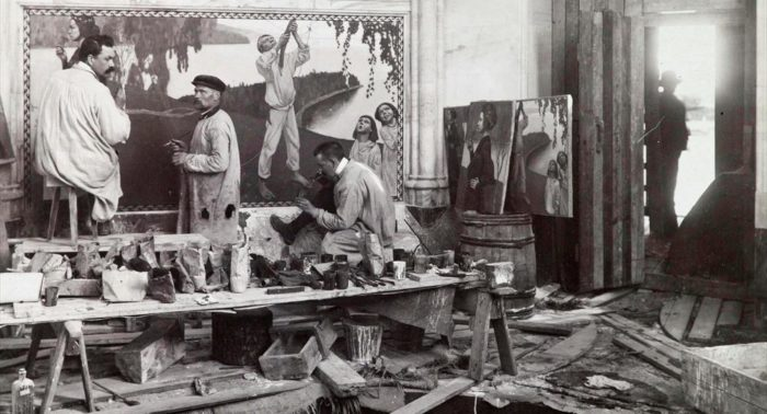 "In this 1902 photo, Akseli Gallen-Kallela (left) and assistants are painting the fresco ""Spring"" in the Jusélius Mausoleum in the west-coast town of Pori."