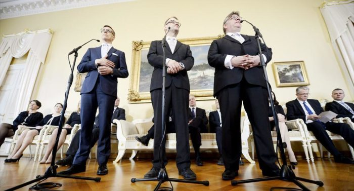 Prime Minister Juha Sipilä (middle) announces the formation of his new cabinet, flanked by Minister for Foreign Affairs Timo Soini (right) and Minister of Finance Alexander Stubb.