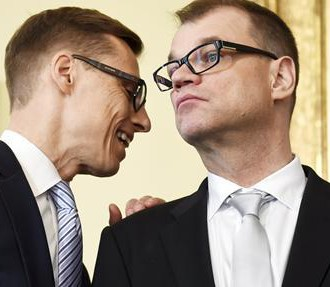 Passing the torch: Former prime minister Alexander Stubb (left) now dons the mantle of finance minister, while Juha Sipilä takes over as the new head of the government.