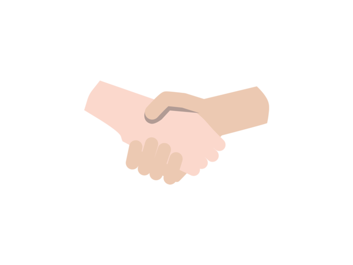 Two hands meet in a handshake.