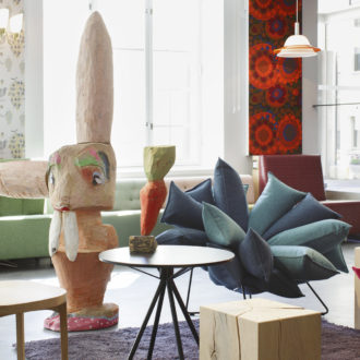 """In the museum lobby you can rest on sofas and armchairs from different periods – and stroke """"city bunnies"""" designed by artist Jasmin Anoschkin."""