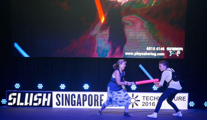 Slush organises gatherings in many different countries; there is time for both business and fun, such as this saber tag match at Slush Singapore.