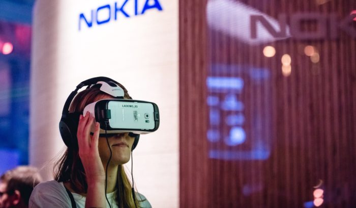 Trying to see what the future holds: With the Nokia stand visible in the background, a Slush participant tests a Samsung product.