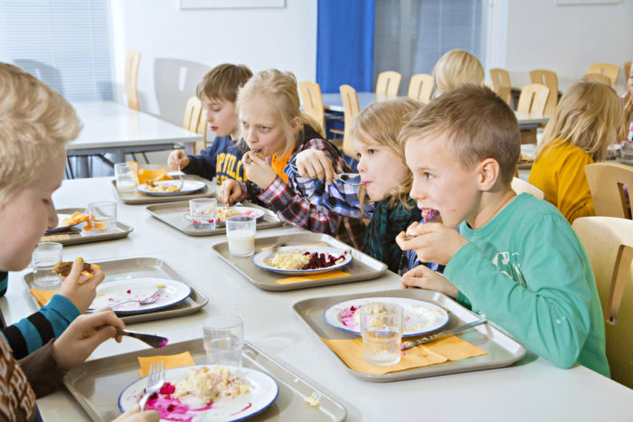 Pupils eating at the school cafeteria.