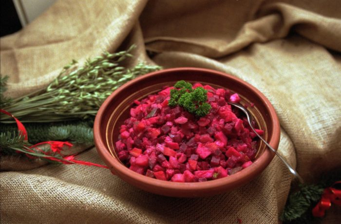 A bowl contains chopped pink and red vegetables.