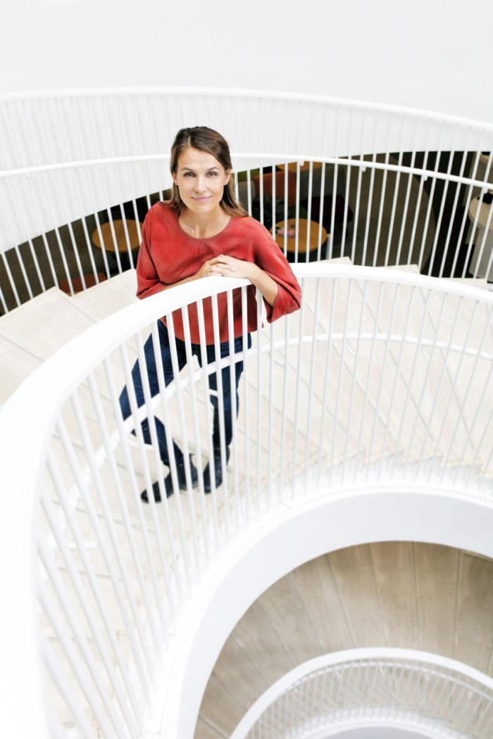 Maria Ritola posing in a spiral staircase.