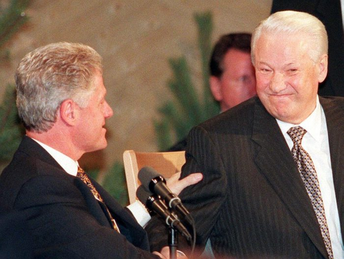 Bill Clinton squeezing the arm of Boris Yeltsin.