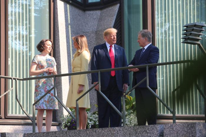 Sauli Niinistö and Jenni Haukio standing on a balcony with Donald and Melania Trump.