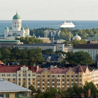 A panoramic view of Helsinki showing the city centre and the sea in the background.