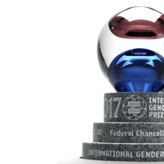 The International Gender Equality Prize trophy; a red and blue glass sphere on a granite base.