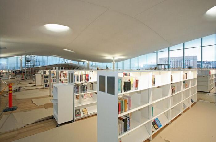 White bookshelves inside Oodi.