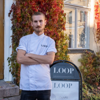 Chef Ossi Paloneva posing in front of restaurant Loop.