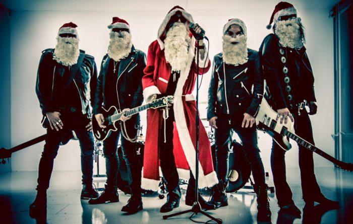 The band 69 Eyes wearing Santa Claus hats and beards.