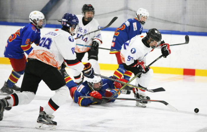 Hockey players fighting for the puck.