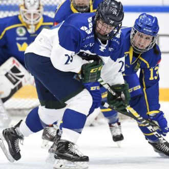 Finland's Saana Valkama fighting off Sweden's Elin Lundberg.