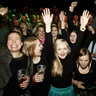 A crowd of happy-looking people celebrating the election results.