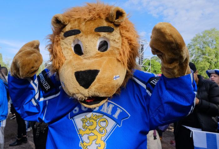 A lion mascot wearing the Finnish ice hockey jersey.