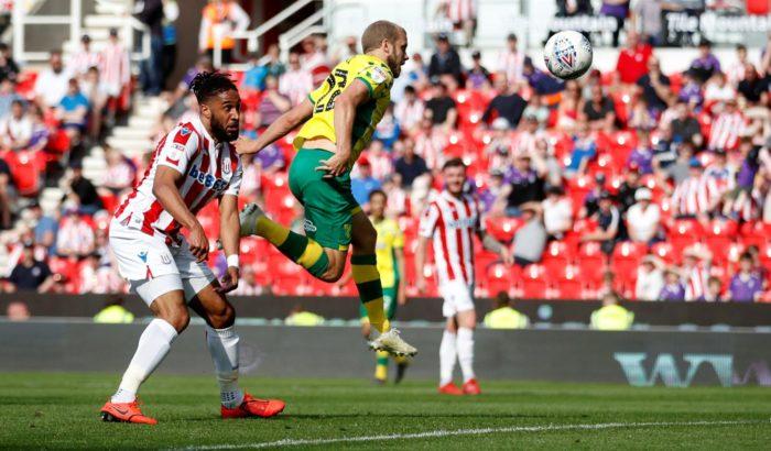 Footballer Teemu Pukki jumping to head the ball.