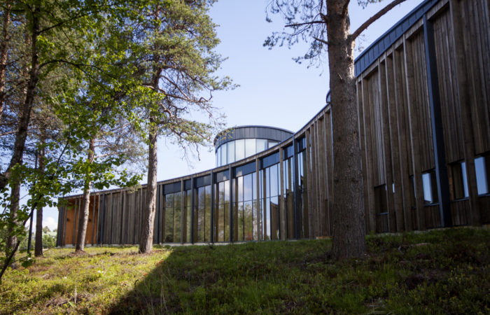 The Sámi cultural centre; a wooden building with floor to ceiling windows.