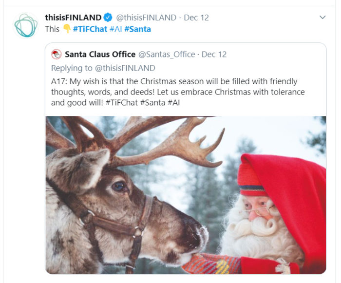 A screenshot from Twitter; Santa Claus petting the muzzle of one of his reindeer.
