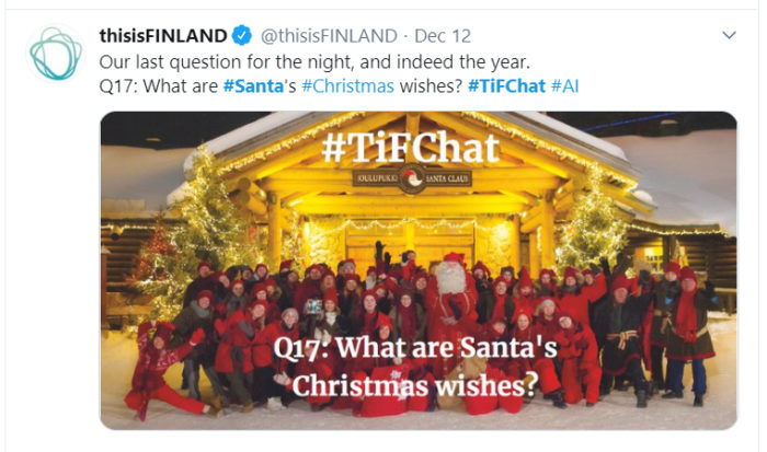 A screenshot from Twitter; Santa with all of his elves in front of the Santa Claus house.