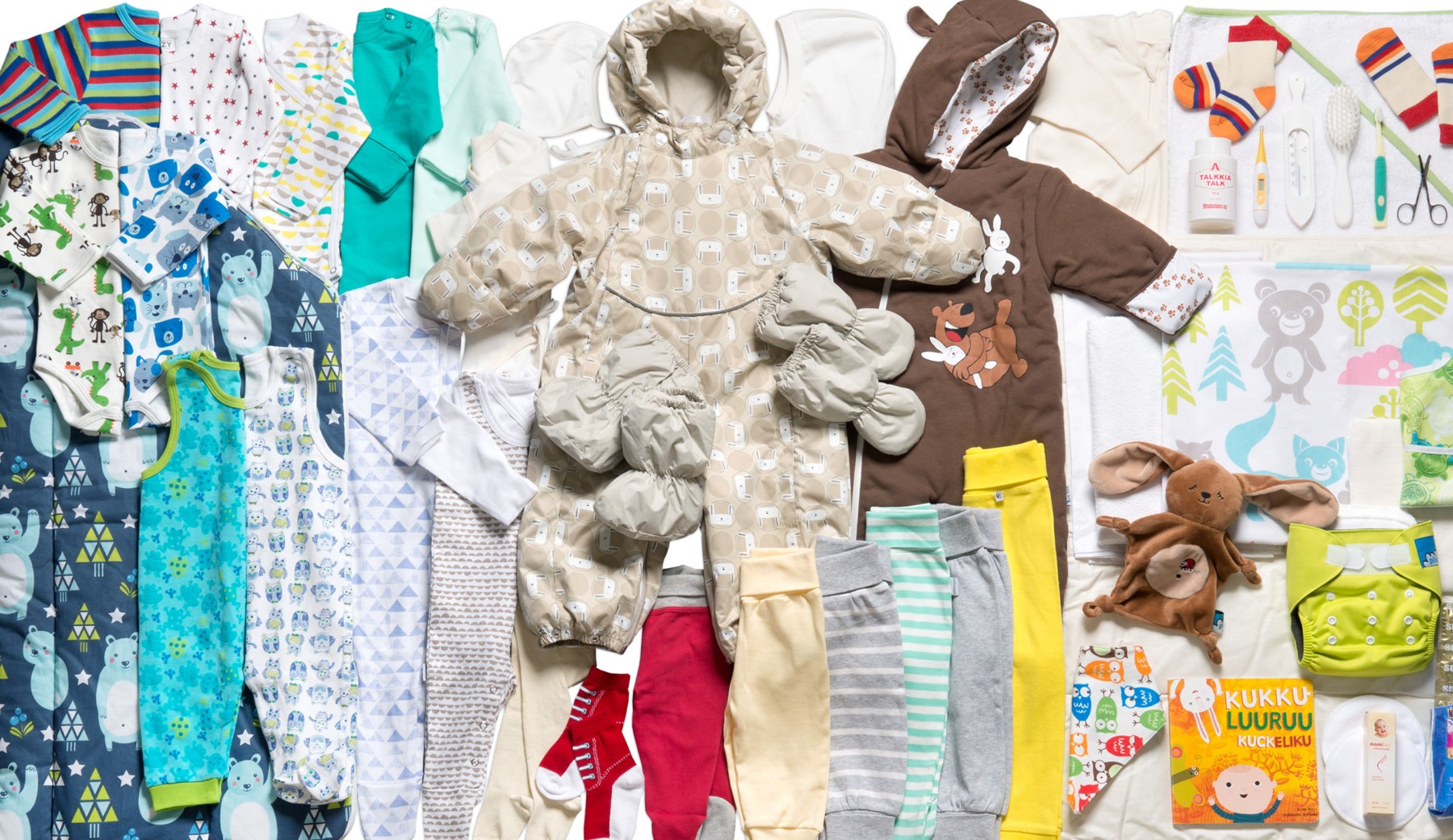Contents of the Finnish maternity package, for example baby clothes and toys.,