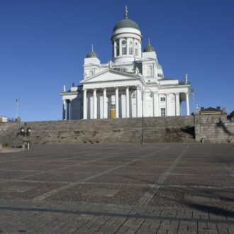 Helsinki's Lutheran Cathedral is in the background overlooking an empty Senate Square in the spring of 2020.