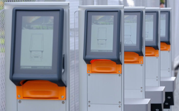 A row of screens, each mounted on a post.