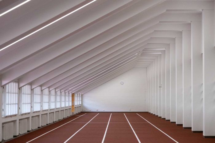 A straight indoor stretch of running track.