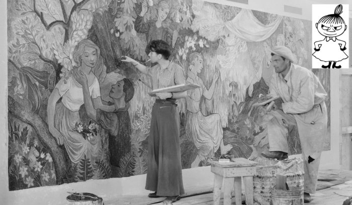A woman is painting part of a large painting showing people at a picnic, while a man looks on. To one side of the photo, there is an ink drawing of a small female character with her hands on her hips.